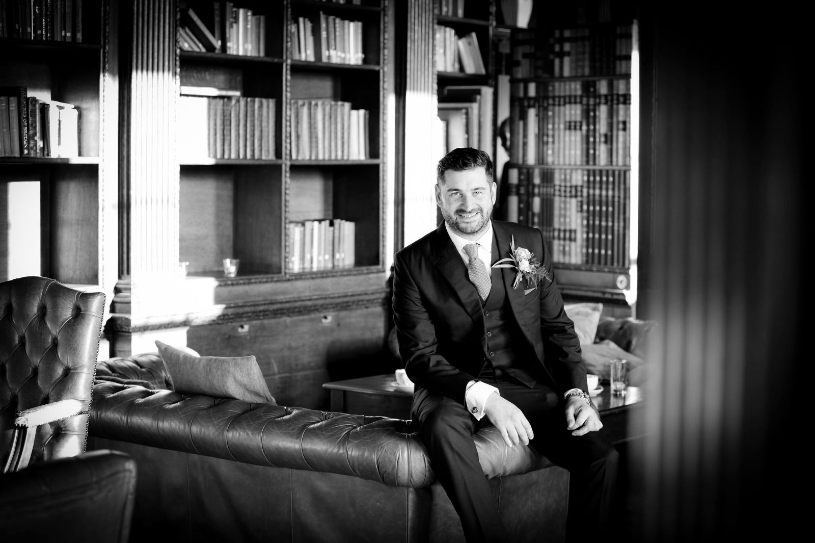 Gosfield Hall wedding Groom in Library